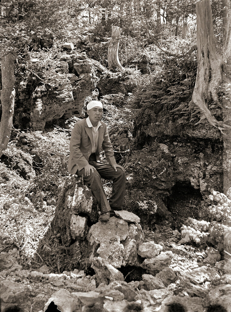 Man on a Rock in Forest, 1930s Japan.