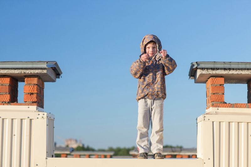 boy standing on the roof