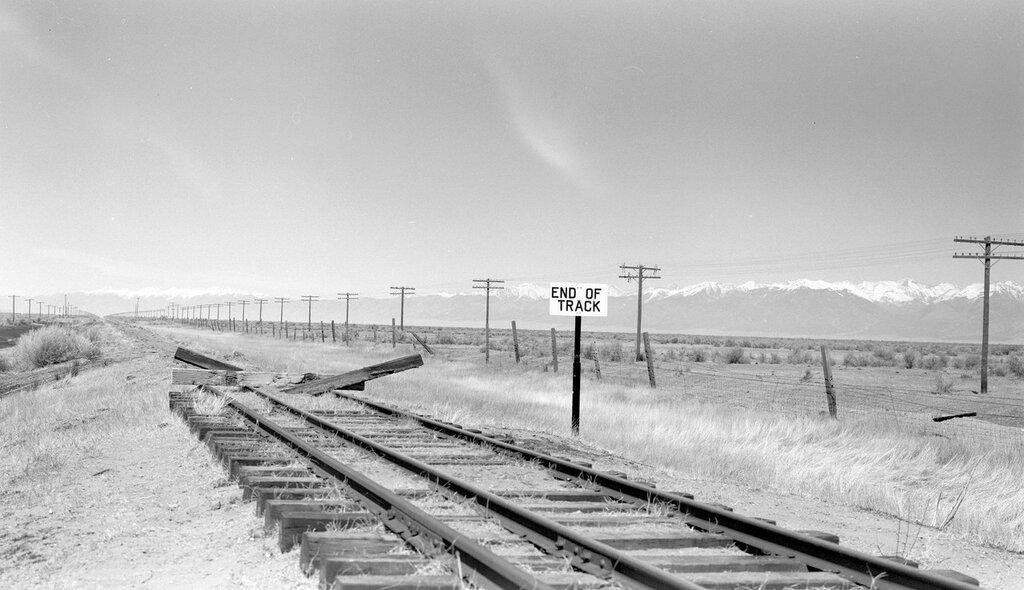 Denver & Rio Grande Western. View of end of 3-rail track. Hooper, Colo., March 25, 1951.