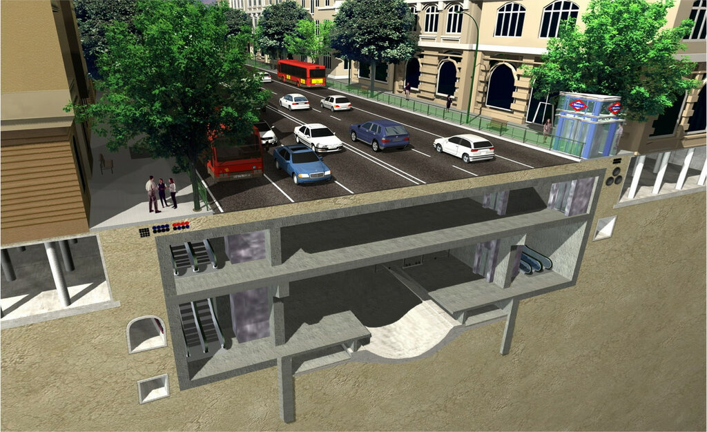 Через готовую в конструкциях станцию протягивается сооружающий перегонный тоннель щит, строятся платформы