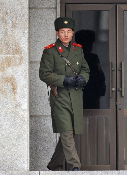 A North Korean soldier looks toward the