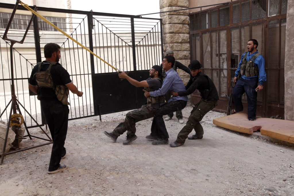 Free Syrian Army fighters launch a home made bomb using a catapult during clashes in Aleppo