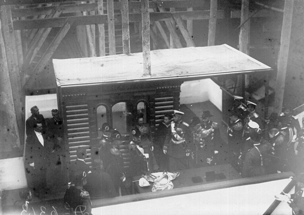 14. Император Николай II и сопровождающие его лица на транспорте перед началом освящения. 1909