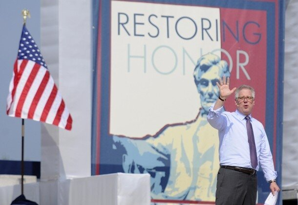Beck waves at thousands of supporters at his Restoring Honor rally on the National Mall in Washington