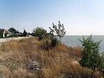 На берегу, в посёлке Ясенская Переправа