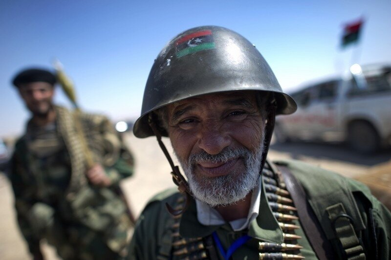 Libyan rebels pose near Brega on April 4