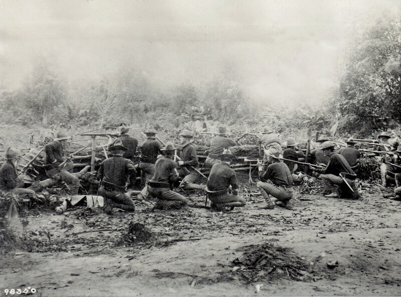 Company D, 30th Volunteer Infantry Regiment takes position behind hasty positions in the outer Manila trenches at Pasay. The company was commanded by Captain Burr. Only a handful of the company are represented in the photo which was staged for the photo