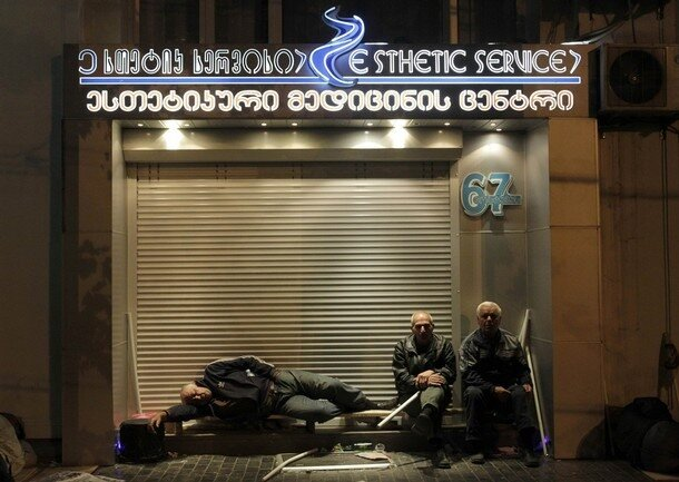 Activists rest during an overnight opposition rally in Tbilisi