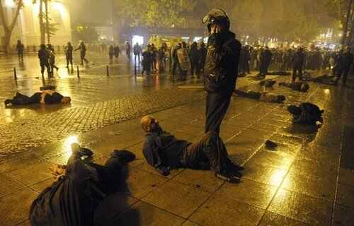 Police detain protesters during clashes in Tbilisi