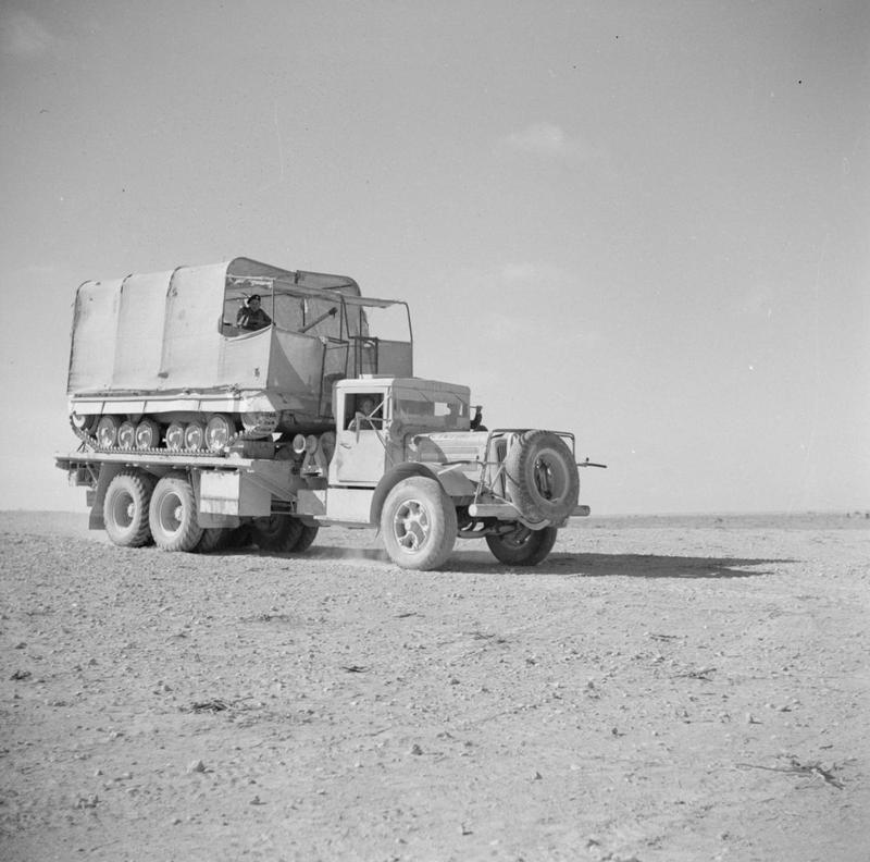 A transporter carrying a Valentine tank camouflaged as a lorry, May 1942