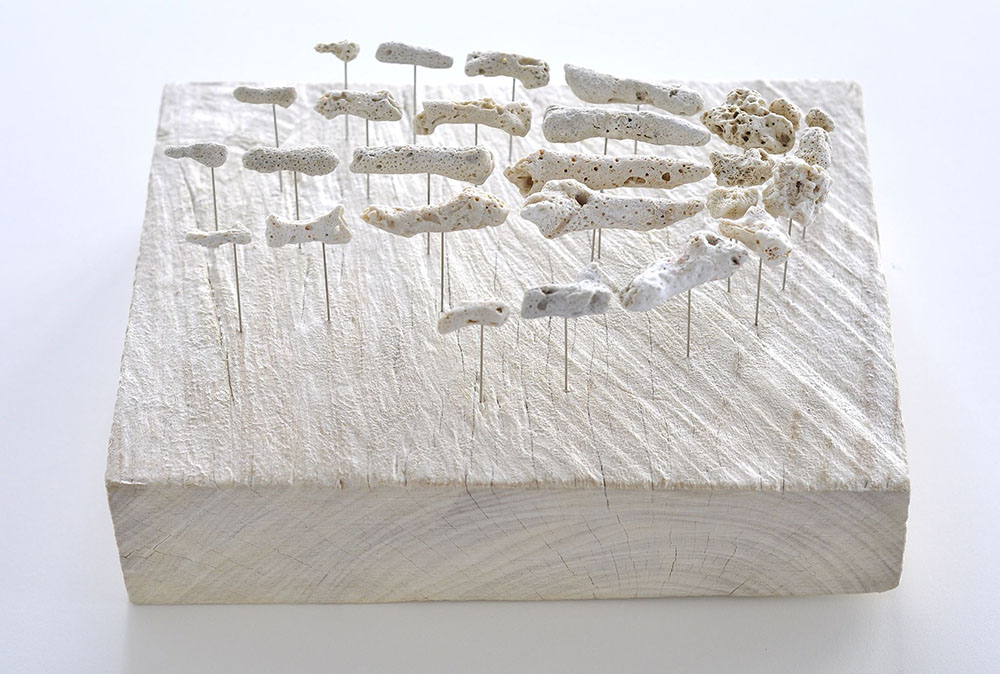 With parched white pieces of found sea coral, artist Gregory Halili has been creating skeletal parts