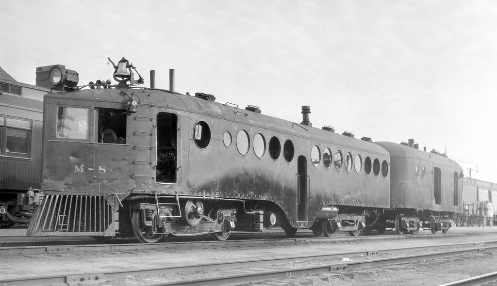 Union Pacific motor car, engine number M-8, engine type MCKEEN, with trailer T-12. at Sterling, Colo., July 27, 1927.