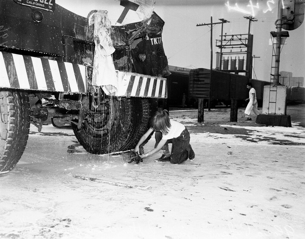Train vs. milk truck (French Avenue and Marmion Way), June 11, 1951. Gloria Pufano -- 5 years (holds pet kitten under stream of cream from smashed mild truck).