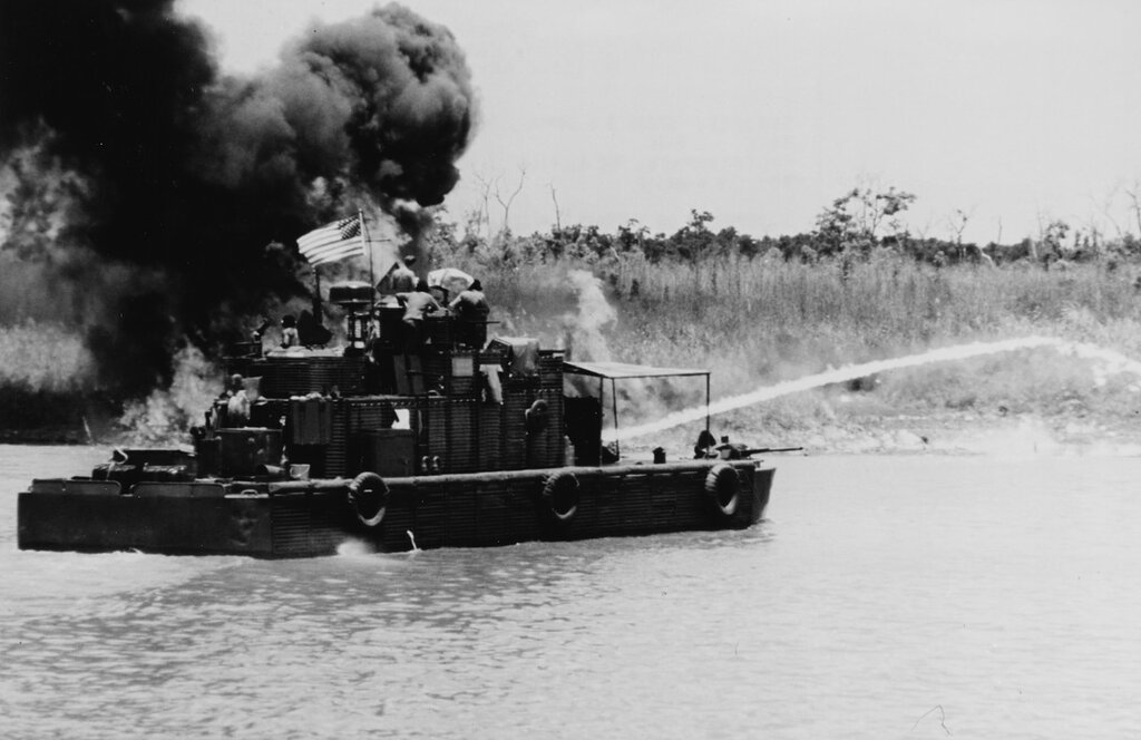"U.S. Monitor, Commonly referred to as a ""Zippo"" because of the flame throwers, clears the overgrowth from the river banks, Republic of Vietnam, May 1970."