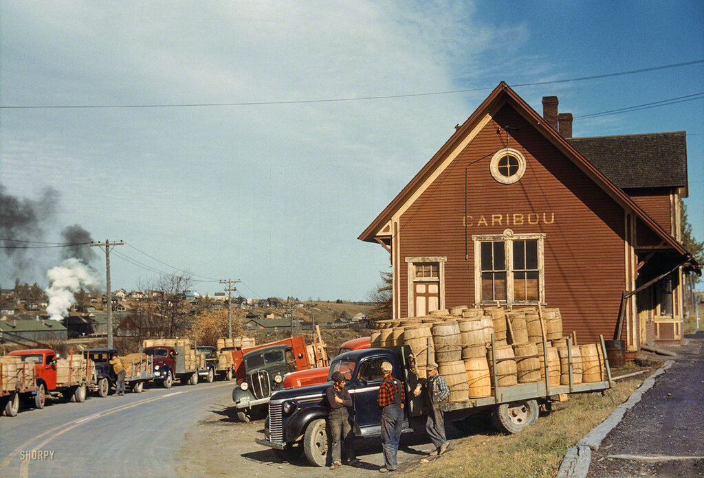 October 1940. Trucks outside of a starch factory, Caribou, Aroostook County, Maine.