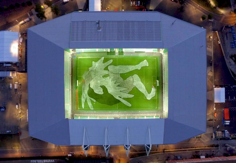 Ella and Pitr just painted a giant character in the Geoffroy Guichard stadium