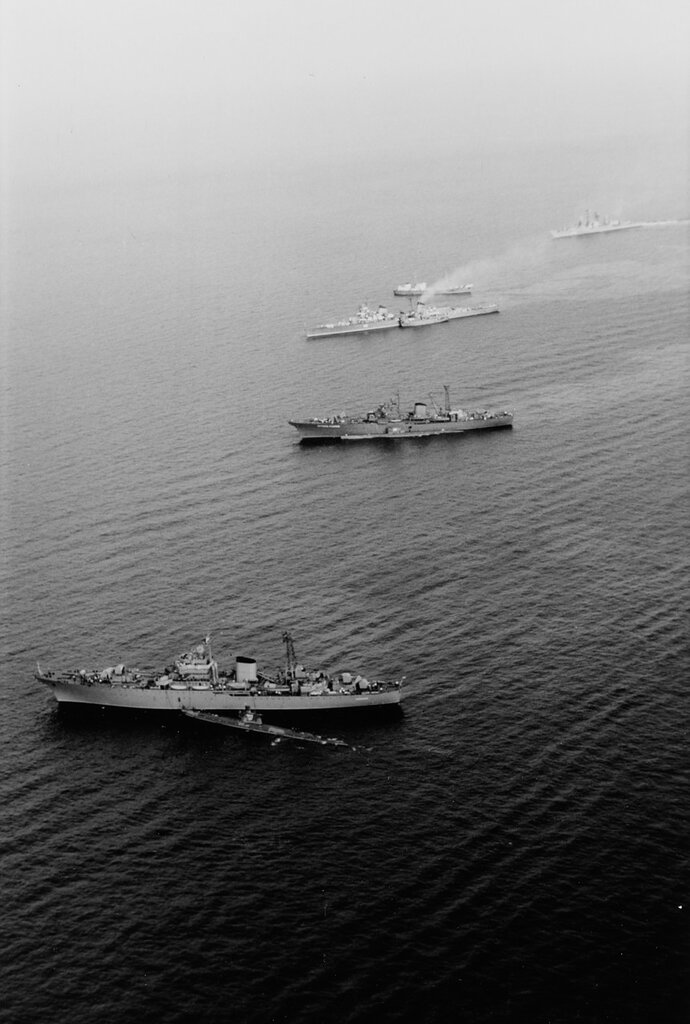 Soviet Warships in the Mediterranean off Crete, 5 June 1967. The ships present include two Don-class submarine tenders with submarines alongside, the Kirov-class cruiser SLAVA (ex-MOLOTOV), a small merchant-type ship, and a Kashin-class guided missile des