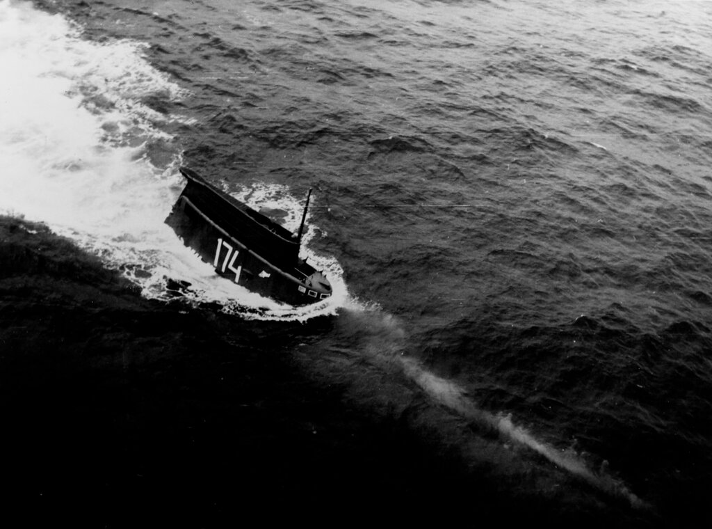 A partially submerged Soviet Zulu class diesel attack submarine (SS), photographed during July 1962.