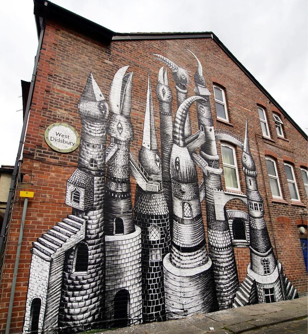 A Village Encapsulated Inside a 5-Story Robot's Head and Other Recent Murals by 'Phlegm'