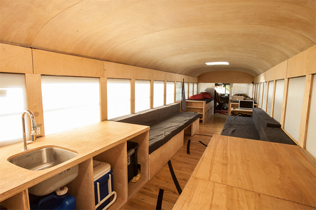 Architecture Student Converts Old Bus into Comfy Mobile Home Complete with Repurposed Gym Floor (7 pics)