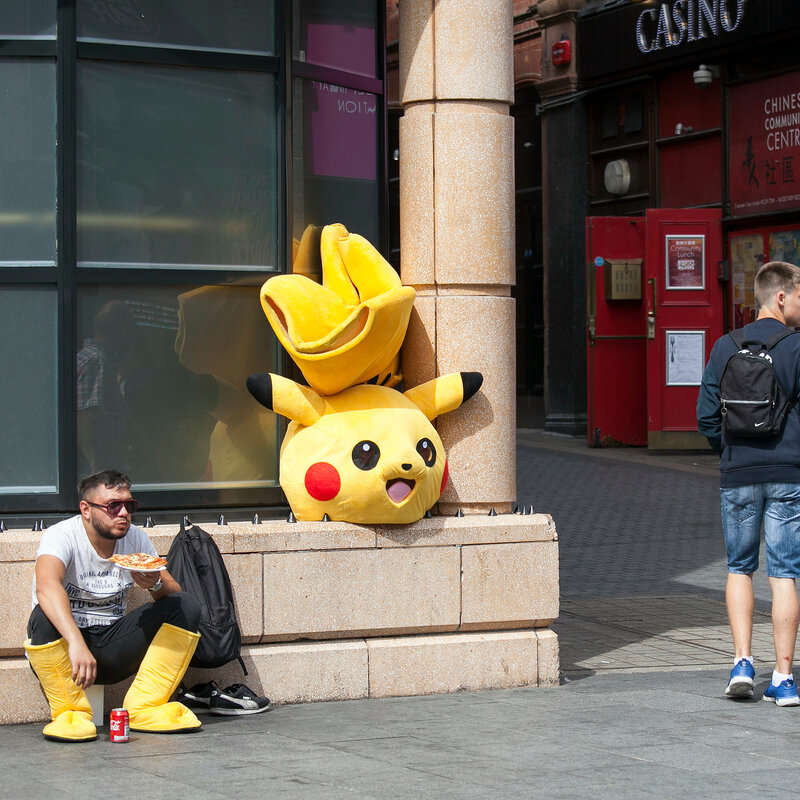 Actor in Pokemon costume is having lunch in Chinatown area
