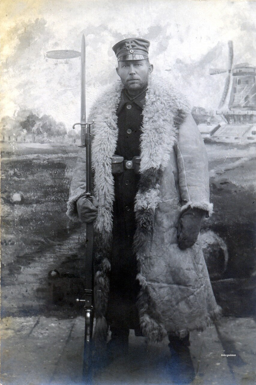 Nothing on reverse.A Landsturmmann sentry, armed with an obsolete 1871 Mauser and S71 bayonet.Like the fellow in the next photograph, he is wearing a heavy fleece overcoat over his black, single-breasted great-coat. Sentry duty was often involved