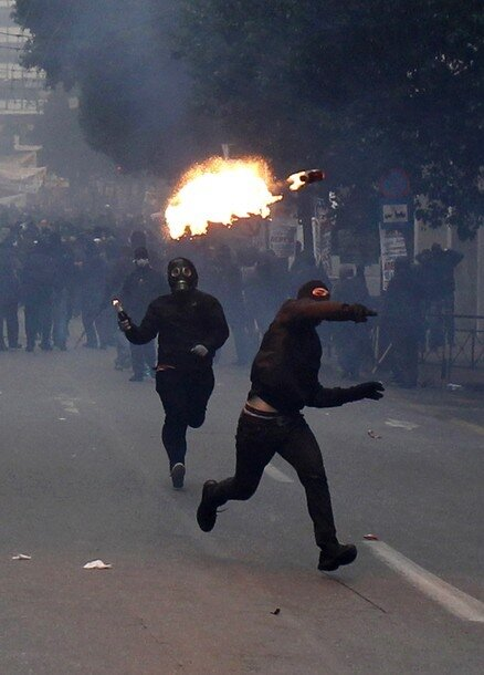 Protesters throw petrol bombs at police during riots in Athens
