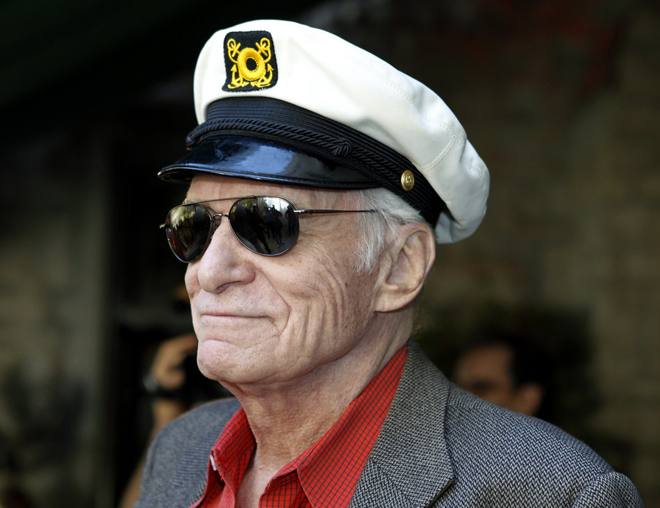 Playboy Magazine founder Hefner smiles at the news conference for the upcoming Playboy Jazz Festival, at the Playboy Mansion in Los Angeles