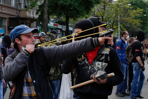 A Pro-Russian activist slingshots objects at supporters of the Kiev government in the streets of Odessa