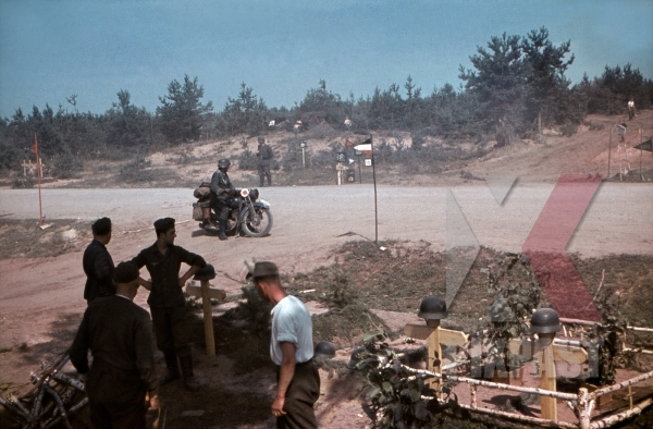 stock-photo-feldgendarmerie-field-police-with-gorget-on-motorbike-cross-roads-army-graveyard-with-helmets-19th-panzer-division-1941-12262.jpg
