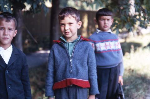 three boys posing for the camera in long sleeved clothing.JPG