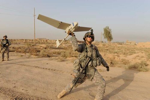 U.S. Army Spc. Cal Treen of Northville, Mich., with 2nd Battalion, 5th Cavalry Regiment, 1st Brigade Combat Team, 1st Cavalry Division, launches an Unmanned Aerial Vehicle called the Raven to provide an aerial view of the area in support the Iraqi army. S