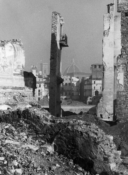 View of the ruins of the area of Oltramo, Florence. The photograph was taken before reconstruction, following the damages caused by the war that hit the city. In the background the dome of the Cathedral, the bell tower of Giotto and the church of Orsanmic