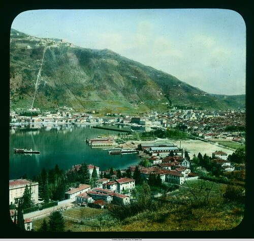 Como: aerial view of the city, with funicular to Brumate in the distance