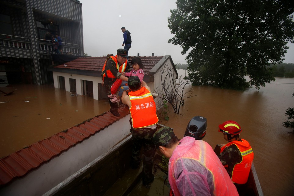 Rescuers save residents from a flooded area in Wuhan