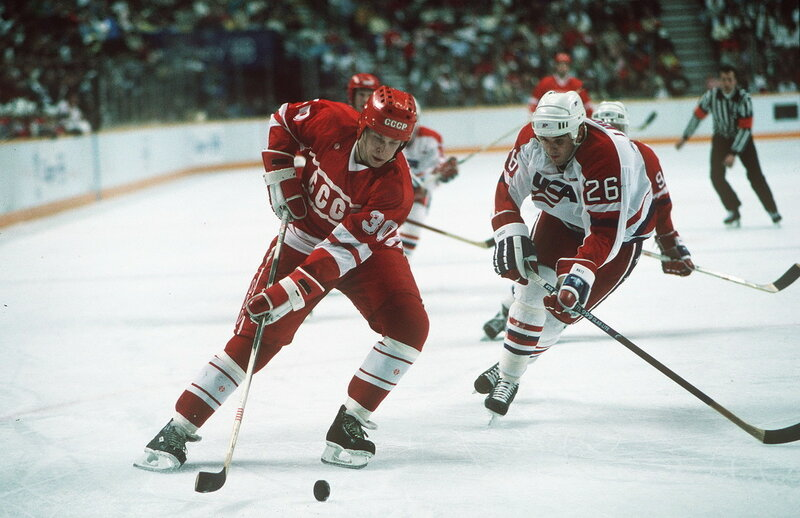 Sport. 1988 Winter Olympic Games. Calgary, Canada. Ice Hockey. USSR 7 v USA 5. Russia's Anatoli Semenov beats USA's Peter Laviolette.