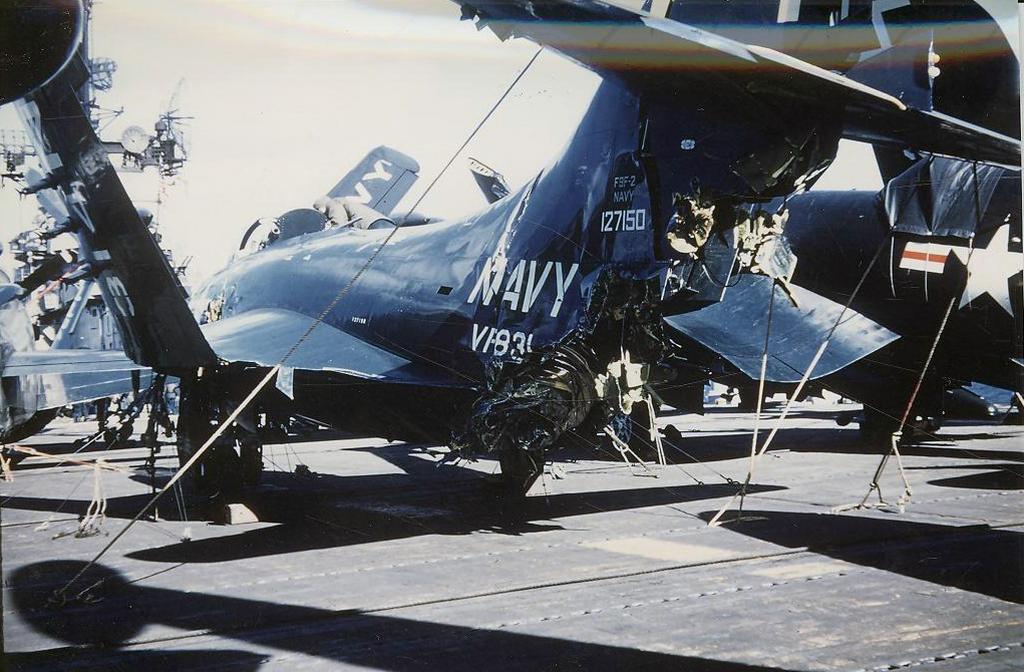 F9F-2PantherofFighterSquadronVF831itstailsectionheavilydamagedwhenitwashitbyanotherplaneattemptingtolandonboardthecarrierAntietam.jpg