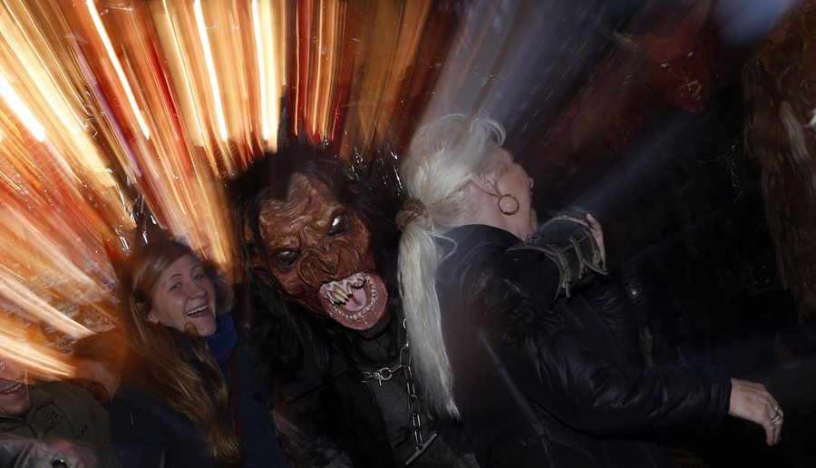 A man dressed as Krampus takes part in a parade at Munich's Christmas market on December 14, 201