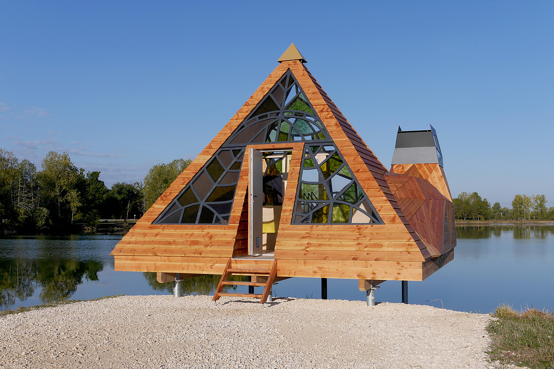 Architectural Cabin on the Side of a Lake in France