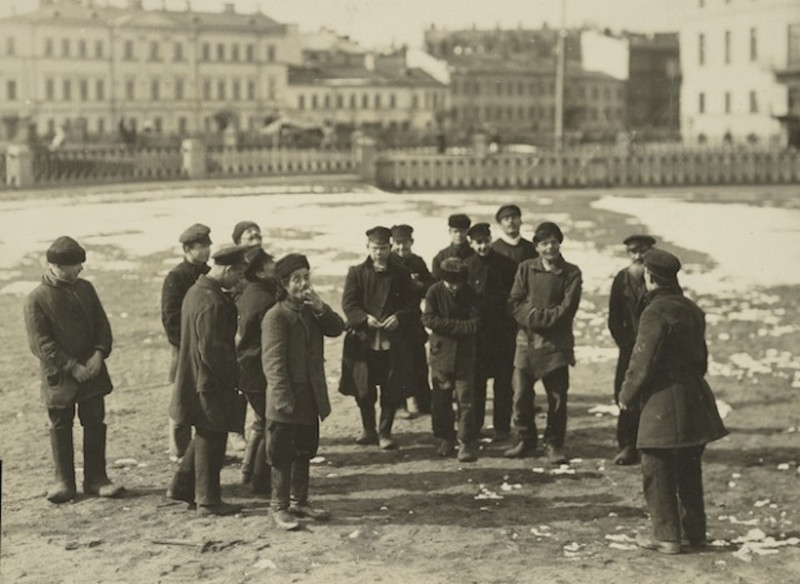 A group of St. Petersburg hooligans pitching pennies.