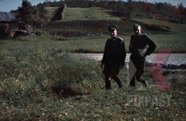 stock-photo-ww2-color-norway--2-german-officers-walking-in-norwegian-field-medals-iron-cross-village-7996.jpg