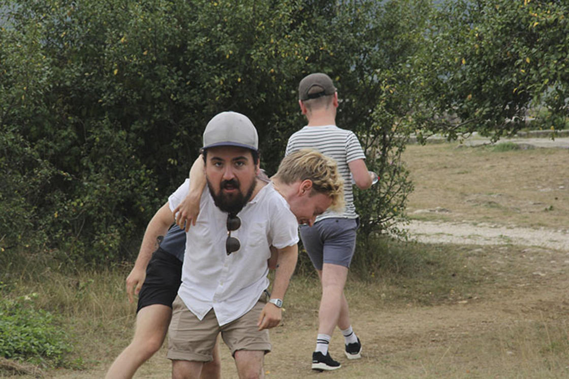He turns his buddies into big kids on his vacation photos