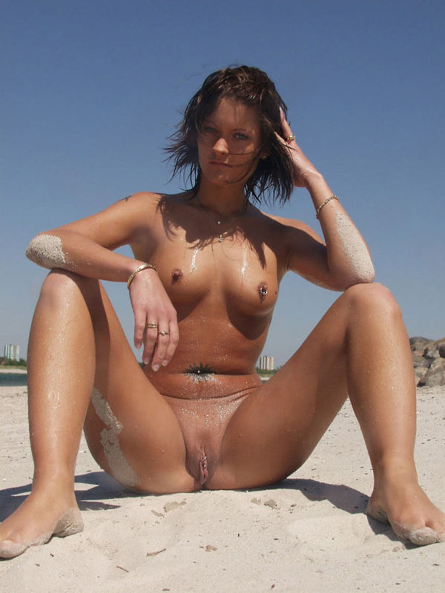 Sexy brunette with perfect body masturbates fully naked in public beach
