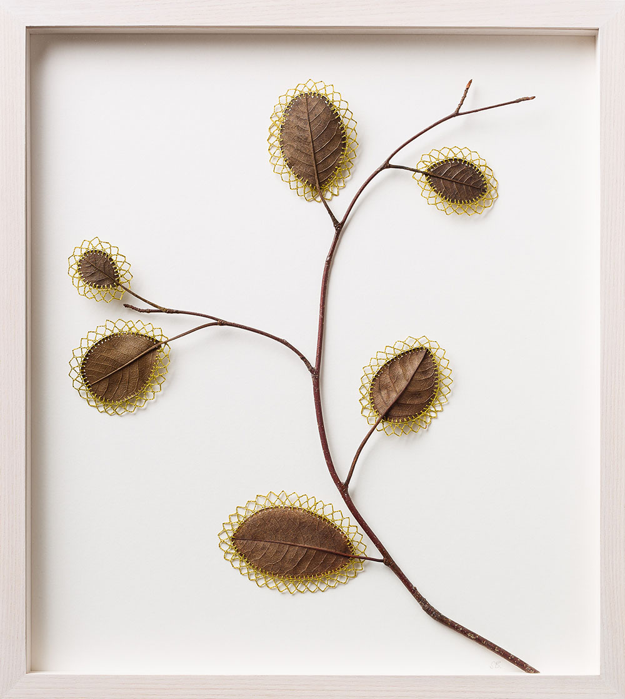 Resurgence ll. 38.9 H x 34.8 W x 3.2 D cm. Magnolia leaves, cotton yarn.