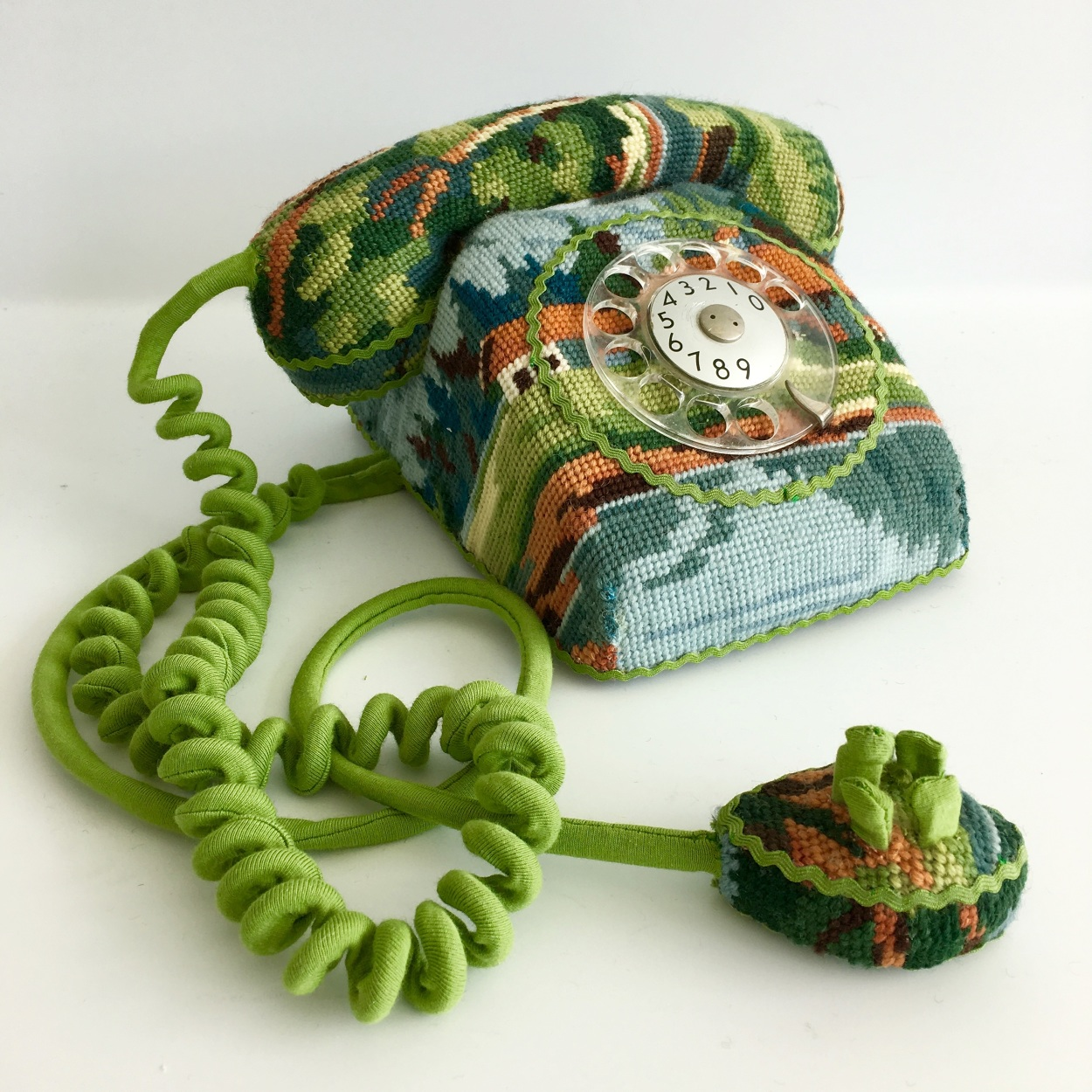 Underneath each of artist  Ulla Stina Wikander 's needlepoint objects is a real, once-functionin