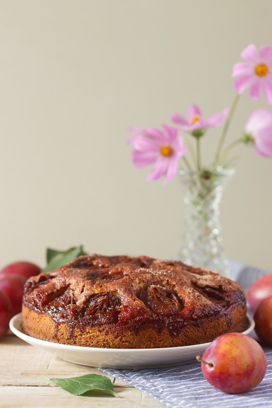 Plum pie or cake with cinnamon and sugar. Selective focus.