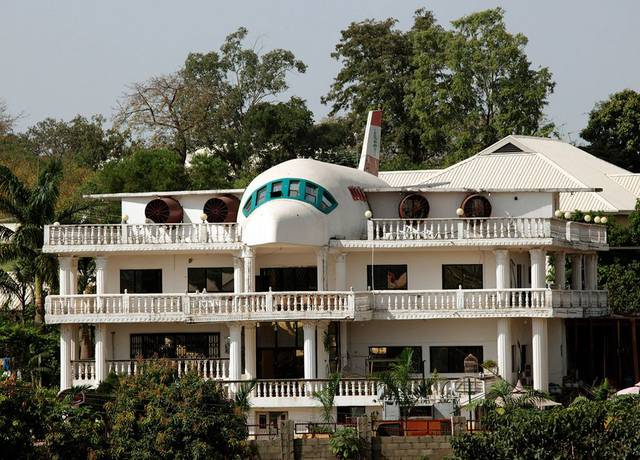 A house partially built in the shape of an airplane is seen in Abuja, Nigeria. Photo by Goran Tomase