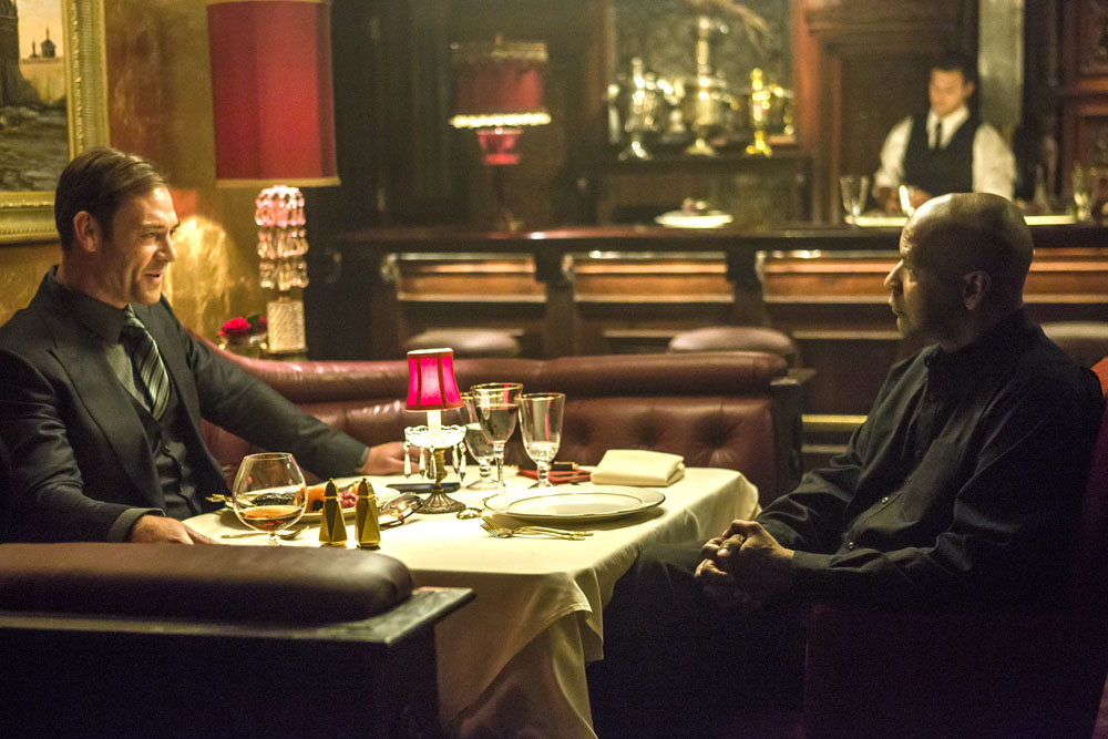 McCall (DENZEL WASHINGTON, right) and Teddy (MARTON CSOKAS) talk business in Columbia Pictures' THE EQUALIZER.