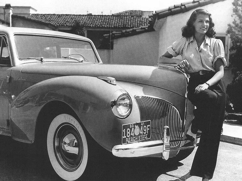 Rita Hayworth with a 1941 Lincoln Continental.