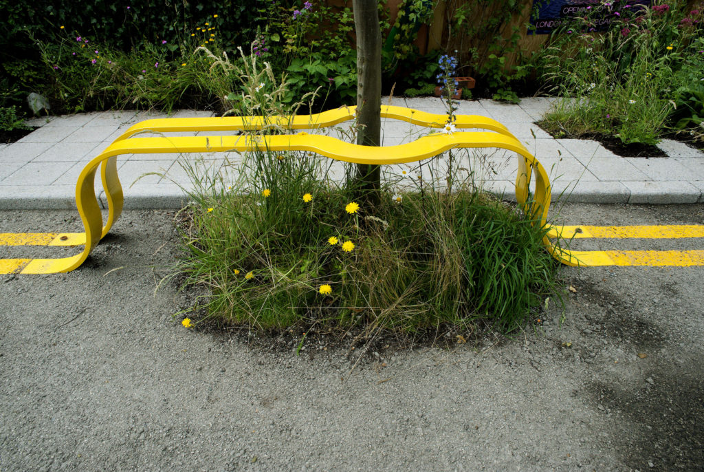 Yellow Street Lines Form a Park Bench Around a Tree in this Temporary Green Space by The Edible Bus Stop